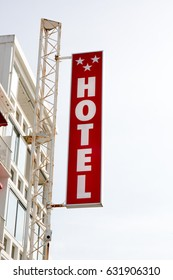 Neon Sign with the word Hotel under sky