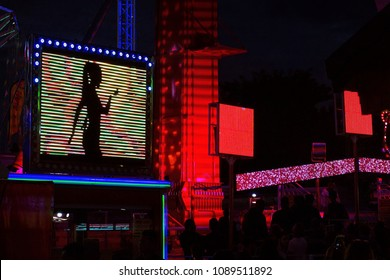 Neon signs showing a dancing lady - Night life in Paris, France.