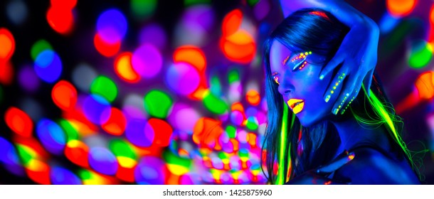 Neon Woman dancing. Fashion model woman in neon light, portrait of beautiful model with fluorescent make-up, Art design of female disco dancer posing in UV, colorful make up. On bright background.