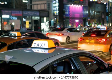 Neons, lights and Taxis waiting for customers, night urban scene on Gangnam Daero Avenue, Seoul, South Korea