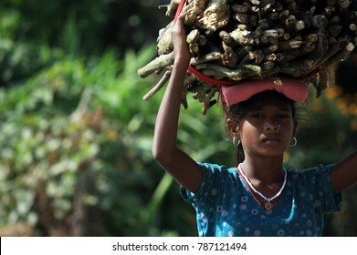 Nepal- 15 06 2014 : Nepal / Woman from Nepal is working very hard conditions.  She is just 14 years old. It was a hot day in Nepal and she was walking around 5 kilometers. Girls need school.