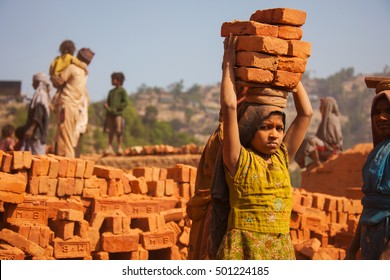 Nepal - Apr 6, 2011: A young girl working in a brick factory
