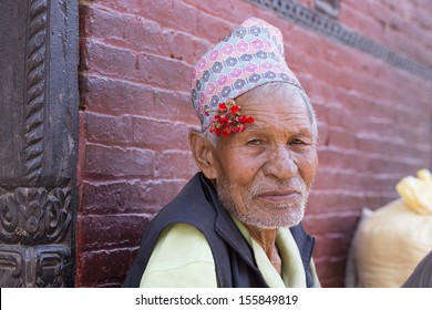 NEPAL, BHAKTAPUR, APRIL 30: Portrait of of an unidentified and old man with a flower next to to his ear living in Bhaktapur, the most beautiful city within the Kathmandu Valley, April 30, 2010, Nepal