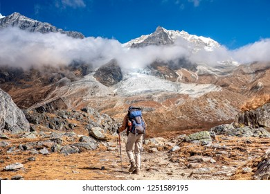 Nepal, hiker at Langtang Valley with Langtang Lirung mountain massif in the background