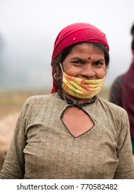 NEPAL, NOVEMBER 29, 2017 : Nepalese women wears traditional dress with mask smiling and looking at camera, Gathmandhu, Nepal in Nov 29, 2017.