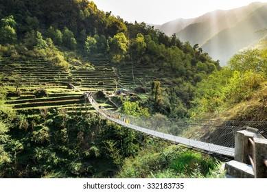 Nepal. Suspension bridge in Himalayan Mountains