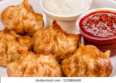 Nepalese traditional dumpling momos (steamed / fried) served with tomato chutney, schezwan sauce and fresh salad.