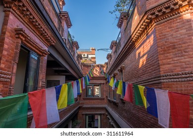 Nepalese traditional houses with Tibetan flags in the street of Thamel, Kathmandu