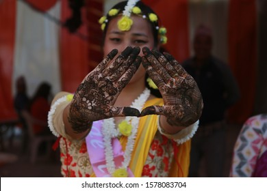 Nepali bride decorated in cultural attire for marriage ceremony with Henna designs, Mehandi Designs