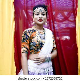 Nepali girl decorated with cultural attire in white color dress, Tharu model, smile and beautiful face