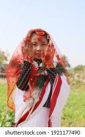 nepali newari small girl in traditional newari cultural dress and mehndi on her hand at damak , jhapa - January 25, 2021