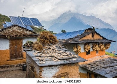 Nepali traditional houses with solar cell panel on the roof. Muri village, Dhaulagiri region.