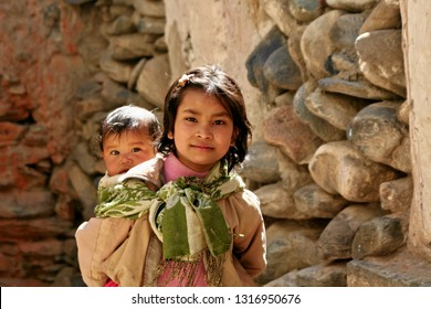 Nepali young girl with baby. 1th April 2009. Himalaya village Kagbeni. Nepal. Asia.
