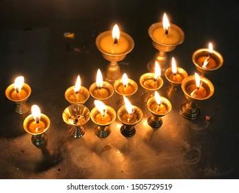 Nepal,kathmandu, 15 september 2019,Shuyambhu Temple, fifteen lamps lightining in ghee early in the morning for lord buddha,symbol of peace