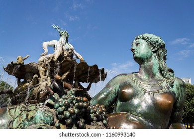 Neptune fountain from 1891 with Greek god Poseidon and woman statue with fishnet and grapes represents river Rhine, Berlin, Germany