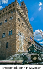 Neptune fountain in Florence. Neptune made of white marble, around Neptune bronze figures of the inhabitants of the water. Behind Neptune you can see the old town hall. Italy