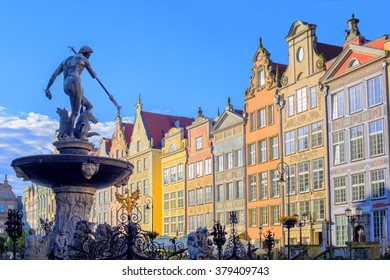 Neptune fountain statue in Gdansk with colorful gothic houses in the background, Poland