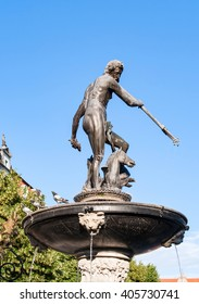 Neptune statue and fountain in Gdansk, Poland, dating from 1549, on blue sky, contaminated with pigeon droppings