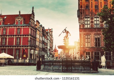 Neptune statue and fountain and Old Town architecture in Gdansk.