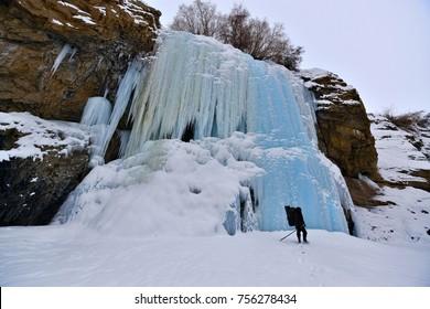 The Nerak fall is frozen waterfall in winter at Chadar frozen river trek, Zanskar region, Ladakh India.