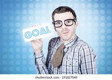 Nerd business man holding goal written on white sign board. Business goals and aspirations concept