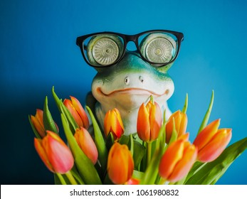 Nerd frog with glasses holding a bunch of flowers and looks like the hidden dream prince