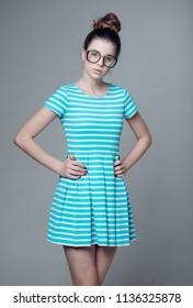 nerd girl. girl in nerd glasses. nerd girl student in glasses and dress. nerd look of cute girl.