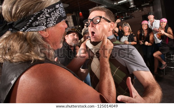 Nerd grabbed by collar in bar fight with tough gang member