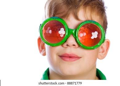 Nerd kid with bug eyed glasses.