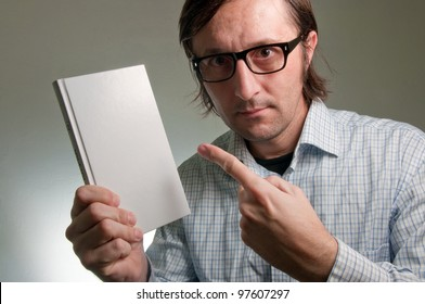 Nerd male holding book with empty covers, this image is a humorous concept photo.