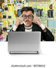Nerd pensive man with myopic glasses looking for solution on electronics technology problem [Photo Illustration]