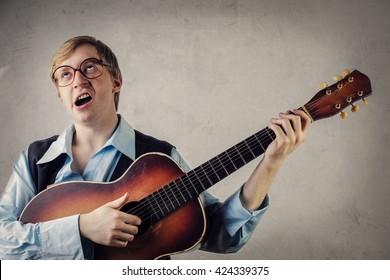 Nerd singing a serenade