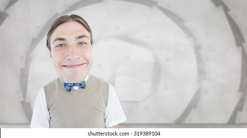Nerd smiling against sheet spiral on grey wall