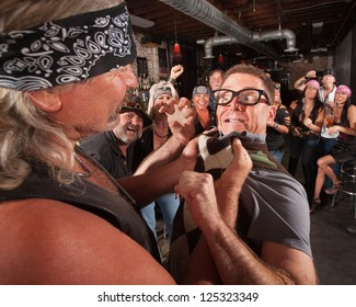 Nerd threatening tough gang member grabbing him by the collar