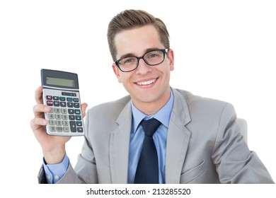 Nerdy businessman showing his calculator on white background