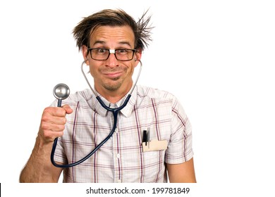 Nerdy doctor with a silly facial expression holds up a stethoscope.