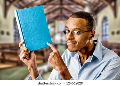 Nerdy looking black african american holding a book