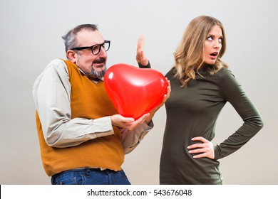 Nerdy man wants to give heart shape balloon to a beautiful woman to show her his love,but she is not interested.Unrequited love