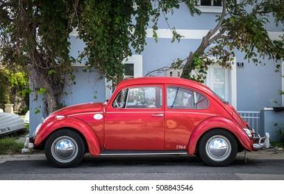 NEREZINE, CROATIA - SEPTEMBER 17, 2016: Red retro car Volkswagen Beetle parked at the city street on September 17, 2016 in Nerezine, Croatia.