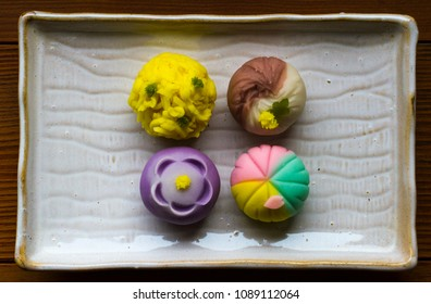 Nerikiri, is authentic Japanese Wagashi, or Japanese sweets made with sweet white bean paste inside. Beautifully and colorfully decorated Japanese sweets on a plate.