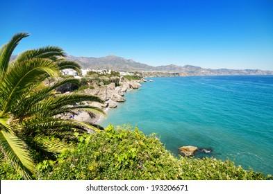 Nerja coastline landscape, famous touristic town in costa del sol, Malaga, Andalusia, Spain.