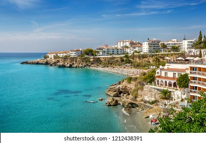 "Nerja, Costa del Sol, Andalusia, Spain - September 30, 2018: Panorama of the coast overlooking the beach ""Playa El Caletilla"" and the beach ""Playa El Salon"" from the Balcony of Europe."