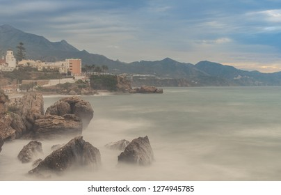 Nerja, Malaga, Andalusi, Spain - November 18, 2018: Sunrise on a stormy day in the well-known Balcon de Europa on the coast of Malaga, Spain