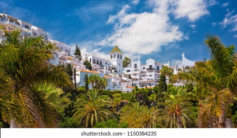 NERJA, SPAIN - 12 MAY, 2018: White color houses in Nerja, Malaga Province on 12 May, 2018.