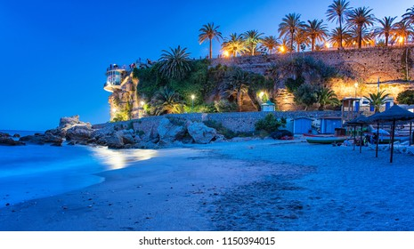NERJA, SPAIN - 12 MAY, 2018: Nice beach with Balcon de Europe at night in Nerja, Spain on 12 May, 2018.