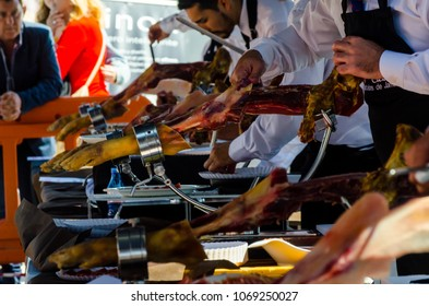 NERJA, SPAIN - APRIL 15, 2018 Traditional competition of professionals in the Jamon Serrano cutting event taking place in Nerja, Andalusia, a great demonstration of skills