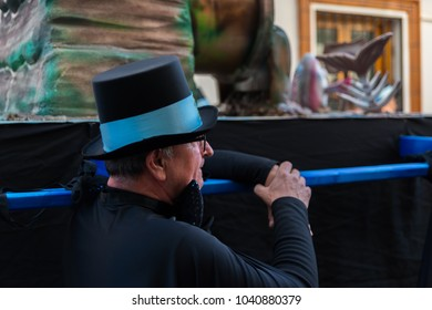 """NERJA, SPAIN - FEBRUARY 11, 2018People in costumes celebrating """"Burial of the Sardine"""" in  Malaga province, funeral parade, carnival"""