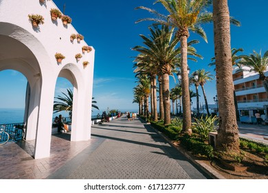 Nerja, Spain - June 20, 2015: People walking near Balcon de Europa in resort town of Nerja in Spain.