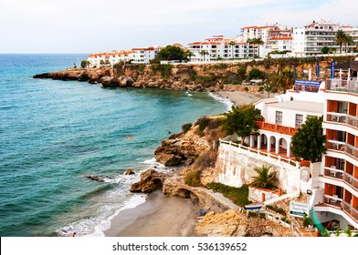 Nerja, Spain. Little touristic town Nerja in Costa del Sol, Andalusia, Spain. It has many restaurants, bars and cafes. Aerial view of the beach