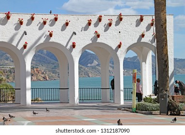 NERJA, SPAIN - MARCH 2018: Archways at the entrance to the Balcon de Europa in Nerja.